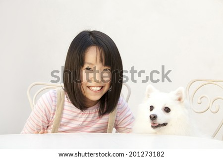 Girls smiling with Spitz