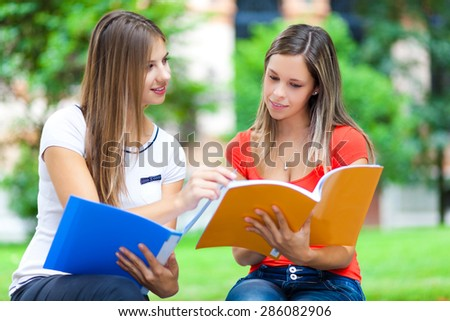 Girls studying at the park - stock photo