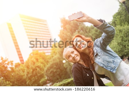 Girls Taking Selfie Mobile Phone - stock photo