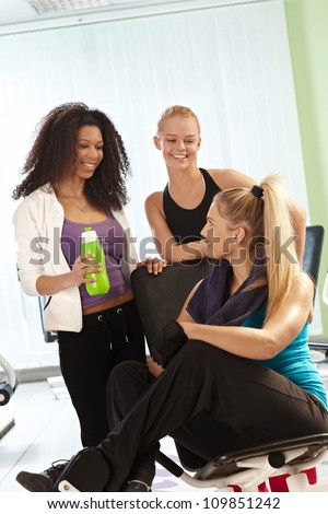 Girls talking and resting after workout at the gym. - stock photo