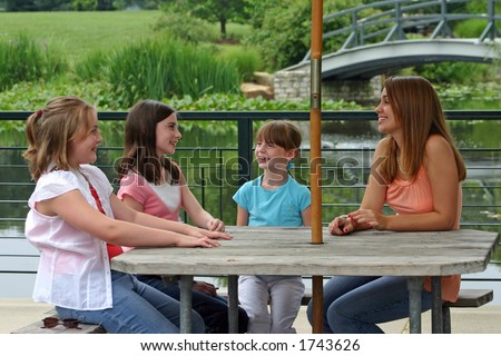 Girls Talking Around Table