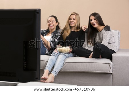 Girls watching movies with popcorn