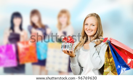 Girls with big shopping bags - stock photo