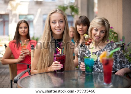 Girls with cocktails - stock photo