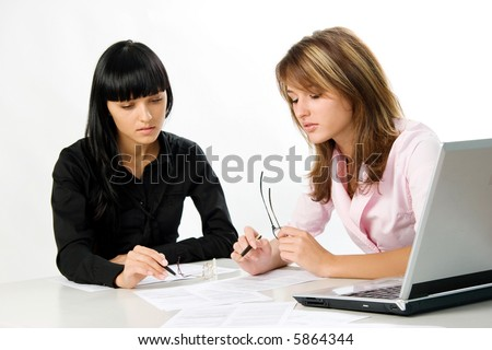 girls with documents and laptop - stock photo