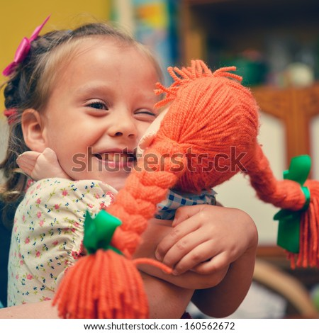 girls with doll - stock photo