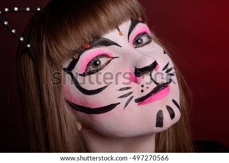 girls with Halloween face art on grey background