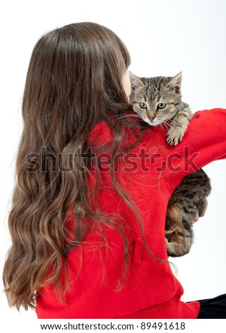 girls with long hair playing with cat - stock photo