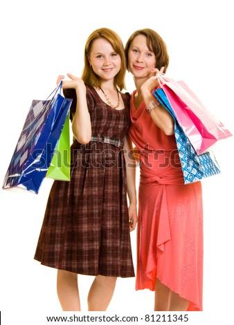 Girls with shopping on white background. - stock photo