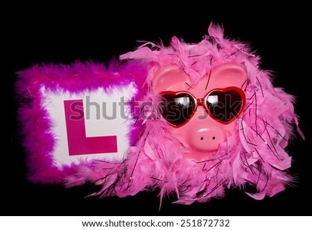 girly piggy bank with L pate cutout - stock photo
