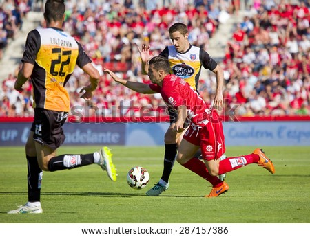 GIRONA, SPAIN - JUNE 7: Alex Granell of Girona in action at the Spanish Second Division League match between Girona FC and CD Lugo, final score 1 - 1, on June 7, 2015, in Girona, Spain. - stock photo