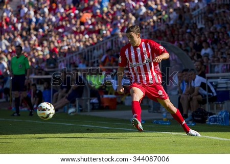 GIRONA, SPAIN - JUNE 7: Jaime Mata of Girona in action at the Spanish Second Division League match between Girona FC and CD Lugo, final score 1 - 1, on June 7, 2015, in Girona, Spain. - stock photo
