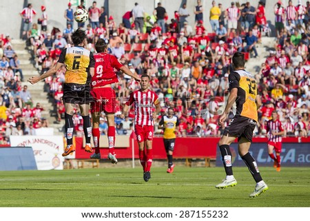 GIRONA, SPAIN - JUNE 7: Some players in action at the Spanish Second Division League match between Girona FC and CD Lugo, final score 1 - 1, on June 7, 2015, in Girona, Spain. - stock photo