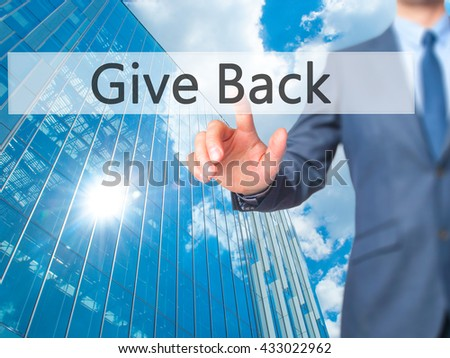 Give Back - Businessman hand pressing button on touch screen interface. Business, technology, internet concept. Stock Photo - stock photo