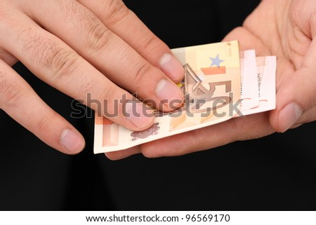 give someone money in the hands, corruption - stock photo