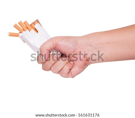 give up smoking fist and crushed pack of cigarettes  - stock photo