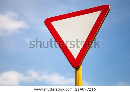 Give way road sign above cloudy sky - stock photo
