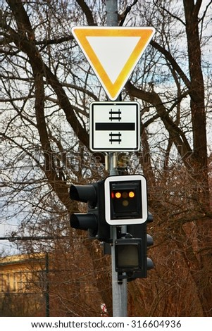 Give way traffic sign with traffic lights - stock photo