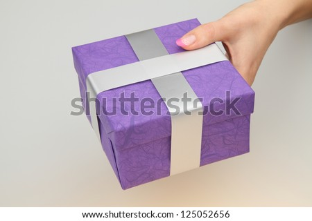 giving gift box - stock photo