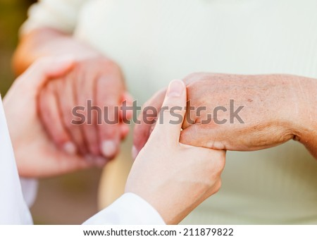 Giving helping hands for needy elderly people - stock photo