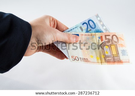 Giving money with hands europe