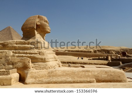 GIZA, EGYPT - MAY 6: Profile of the Great Sphinx of Giza under a blue sky on May 6, 2010 in Giza, Egypt. The Sphinx landmark is a limestone statue with a lion's body and a human head.