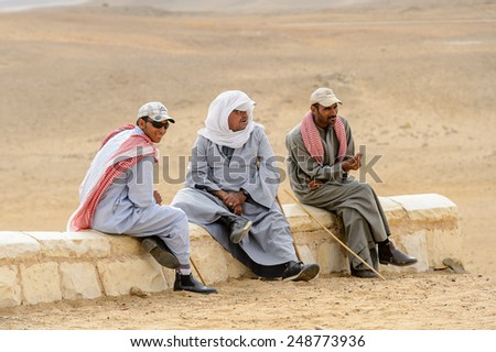 GIZA, EGYPT - NOV 23, 2014: Unidentified Egyptian people at Giza Necropolis, Egypt. UNESCO World Heritage - stock photo