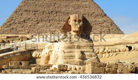 Giza pyramid with Spinx statue over blue sky background in Egypt, panorama view - stock photo