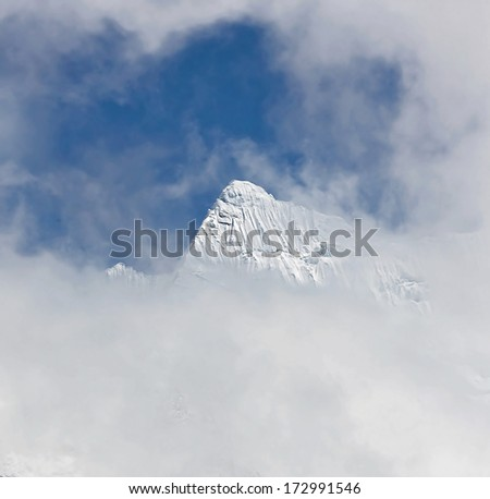 Glacier Chhukhung and untitled peak in the array in district Mount Everest - Nepal, Himalayas - stock photo