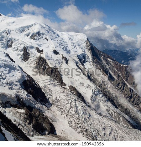 Glacier des Bossons and Glacier du Taconnaz in the Mont Blanc massif, French Alps. - stock photo