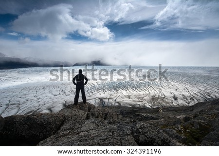Glacier Gray and silhouette of standing woman, Torres del Paine National Park, Patagonia, Chile