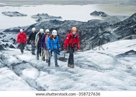 GLACIER, ICELAND - June 19: People hiking the Solheimajokull Glacier in Iceland on June 19, 2015. - stock photo