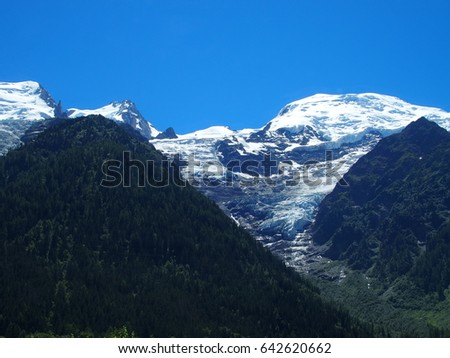 Glacier in alpine mountains range landscape in beauty French ALPS seen from Aiguille du Midi at CHAMONIX MONT BLANC in FRANCE, clear blue sky in 2016 warm sunny summer day, EUROPE on JULY.