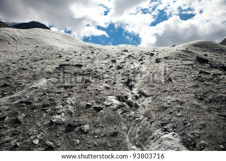Glacier in the mountains gives rise to the river - stock photo