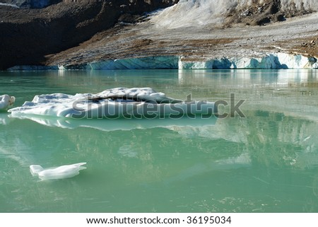 Glacier lake and ice under mountain edith cavell in august, jasper national park, alberta, canada