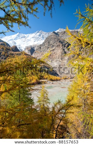 glacier lake hidden in forest above Saas Fee, Switzerland - stock photo