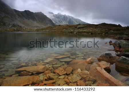 Glacier lake in Retezat mountains, Romania - stock photo