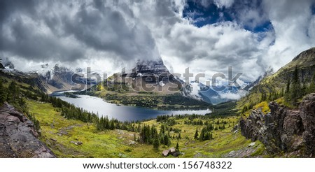 Glacier National Park's Hidden Lake Overlook on a cold, cloudy late summer day - stock photo