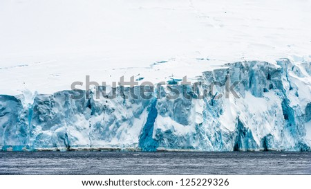 Glacier of Antarctica, South Pole. About 98% of Antarctica is covered by ice. - stock photo