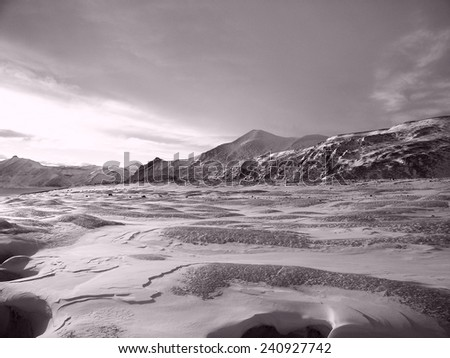 Glacier surface surrounded by mountains in high-Arctic - stock photo