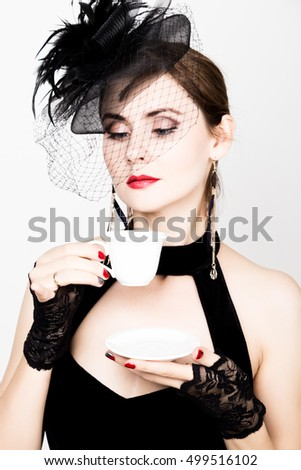 glamor girl with a cup of coffee. fashion woman drinks coffe or hot tea