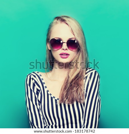 glamor portrait of a beautiful blonde in sunglasses - stock photo