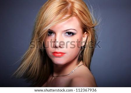Glamor portrait over gray background - stock photo