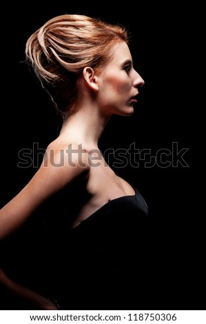 glamor woman with hairstyle over black background - stock photo