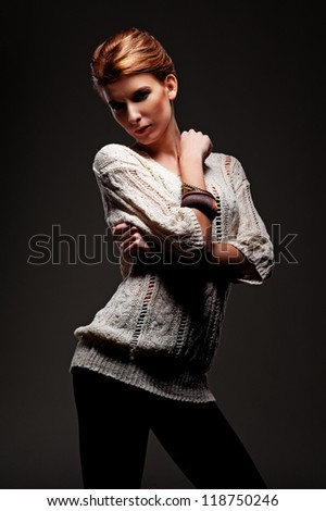 glamor young model posing over black background - stock photo