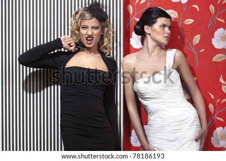 glamorous beauties in evening dresses - stock photo