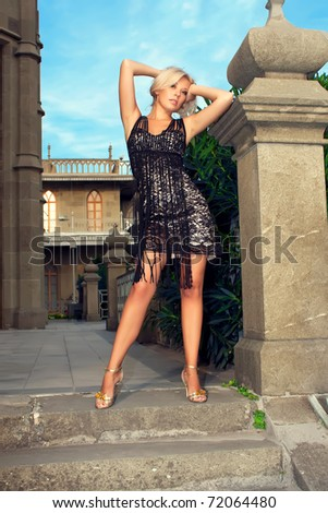 Glamorous beautiful young woman posing in a beautiful dress - stock photo