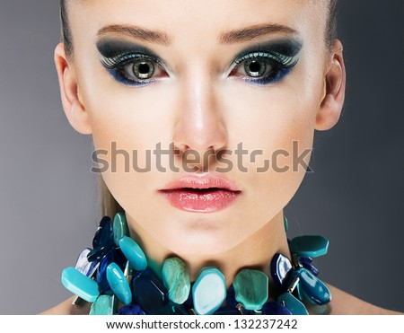 Glamorous Confident Woman in Semi Precious Turquoise Necklace close up - stock photo