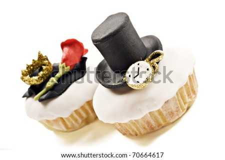 Glamorous cupcakes decorated with top hat and golden crown - very shallow depth of field - stock photo