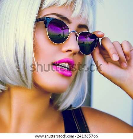 Glamorous fashion lady go shopping . Close up fashion portrait of a beautiful young woman in white wig  stylish retro sunglasses and bright red full lips.Vintage  colors . - stock photo